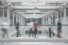 People in hurry. Busy businesspeople in hurry working in big modern factory Stock Photo