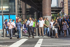 People hurry downtown Manhattan to their offices in early mornin Royalty Free Stock Photo