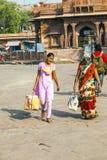 People hurry at the Sadar market at Stock Photos