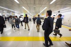 People hurry at Shinjuku Station, Tokyo Royalty Free Stock Photos