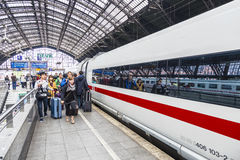 People hurry to the intercity train Stock Photos
