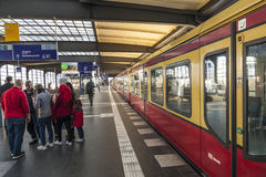 People hurry at train station Friedrichstrasse in Berlin Stock Photography