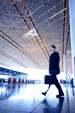 People hurrying in airport Stock Images