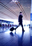 People hurrying in airport Royalty Free Stock Photo