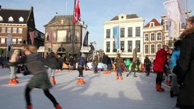 People ice skating in the Christmas market in Gouda, The Netherlands stock footage