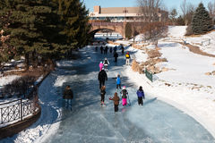 People ice skating on a frozen lake Royalty Free Stock Photos