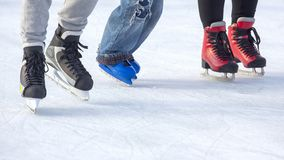 People ice skating on an ice rink. Hobbies and sports. Vacations and winter activities