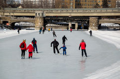 People ice skating on the Rideau Canal, Ottawa for Winterlude. Stock Photography