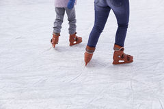 People ice skating Stock Image