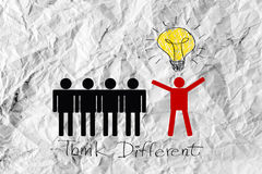 People icons think different idea design on crumpled paper Royalty Free Stock Images