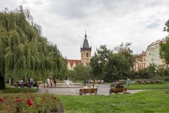 People In A City Park And The New Town Hall In Prague Stock Images