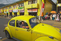 People In A Vintage Car Pass By The Street Of Kandy, Sri Lanka. Royalty Free Stock Photography