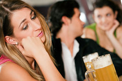People In Bar, Woman Being Abandoned And Sad Royalty Free Stock Image