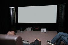 People In Home Cinema Stock Photo