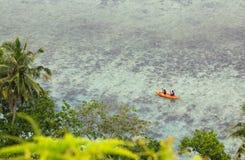 People In Sea Kayak On Island Coast Tropical Sea Royalty Free Stock Photos