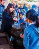 People at the incens burner of the Todaiji Temple in Nara Stock Images