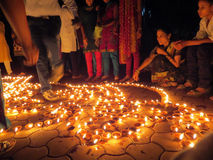 Diwali People. People from India light up traditional earthen lamps on the occassion of Diwali festival celebrations