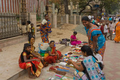 People at Indian streets. Indian women doing shopping (Madurai, Tamil Nadu, India Royalty Free Stock Photos