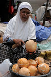 People from Indonesia, Woman selling coconuts Royalty Free Stock Photo