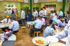 People indoor food court. Singapore. SINGAPORE - JAN 16, 2017 : People at popular food court in Singapore. Inexpensive food stalls are numerous in the city so royalty free stock images