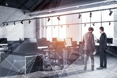 People in industrial style office corner stock images