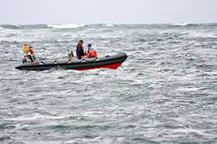 People in an inflatable boat, Ireland. People in a pneumatic boat, floating in the Atlantic Ocean, off the Irish Coast in Doolin, County Clare, Ireland Royalty Free Stock Image