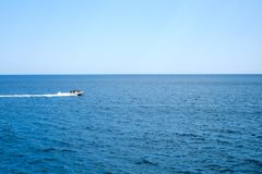 People on an inflatable speedboat. With clear sky stock images