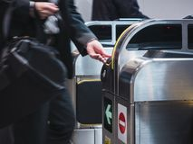 People insert ticket to Ticket Entrance Train station Royalty Free Stock Photos