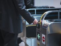 People insert ticket to Ticket Entrance at Train station Stock Photo