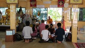 People inside Buddhist temple on Pratumnak Hill by Golden Buddha statue, Pattaya stock video