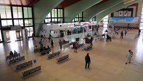 People inside bus station in Abu Dhabi, United Arab Emirates stock footage