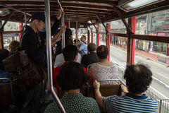 People inside a double-decker tram in Hong Kong Royalty Free Stock Photography