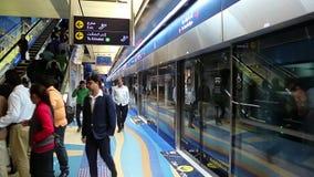 People inside Dubai metro station, United Arab Emirates. UAE, DUBAI, FEBRUARY 1, 2016: People inside Dubai metro station. Dubai Metro is a driverless, fully stock footage