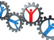 People inside gears - teamwork concept Royalty Free Stock Photography