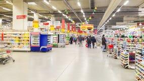 People inside hypermarket. People shopping inside a hypermarket Royalty Free Stock Image