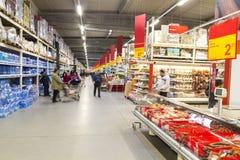 People inside hypermarket. People shopping inside a hypermarket Stock Photos