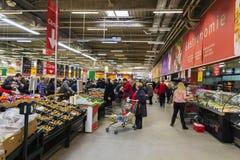 People inside hypermarket. People shopping inside a hypermarket Stock Photography