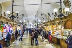 People inside the Kraków Cloth Hall Sukiennice Royalty Free Stock Photos