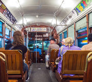 People inside a streetcar in New Orleans. NEW ORLEANS - JULY 14, 2013: people travel with the famous old streetcar St. Charles line  in New Orleans, USA. It is Royalty Free Stock Photos