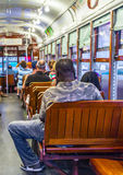 People inside a streetcar in New Orleans. NEW ORLEANS - JULY 14, 2013: people travel with the famous old streetcar St. Charles line  in New Orleans, USA. It is Stock Image