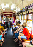 People inside a streetcar in New Orleans Stock Images