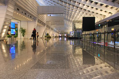 People inside the Taiwan Taoyuan International Airport. Taipei, Taiwan - January 9, 2015: People inside the Taiwan Taoyuan International Airport, the busiest Royalty Free Stock Image