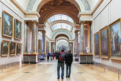 People are inside (visiting) the Louvre Museum. Paris. Stock Photo