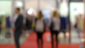 People inside and walking in a shopping mall or center, expo. Background blur people inside and walking in a shopping mall or center, expo stock footage