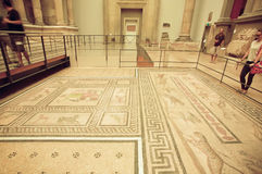 People interested in artifact floor of private house of Miletus with Roman style mosaic. BERLIN, GERMANY - SEPT 2, 2015: People interested in artifact floor of Royalty Free Stock Photography