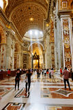 People at the interior of the Saint Peter Cathedral in Vatican. Stock Photography