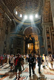 People at the interior of the Saint Peter Cathedral in Vatican. Royalty Free Stock Photos