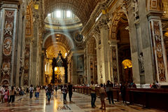 People at the interior of the Saint Peter Cathedral in Vatican. Royalty Free Stock Image