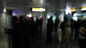People in international airport lobby waiting for plane to arrive. Stock footage stock footage