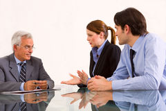 People during an interview. Two men and one women during a job interview Stock Images
